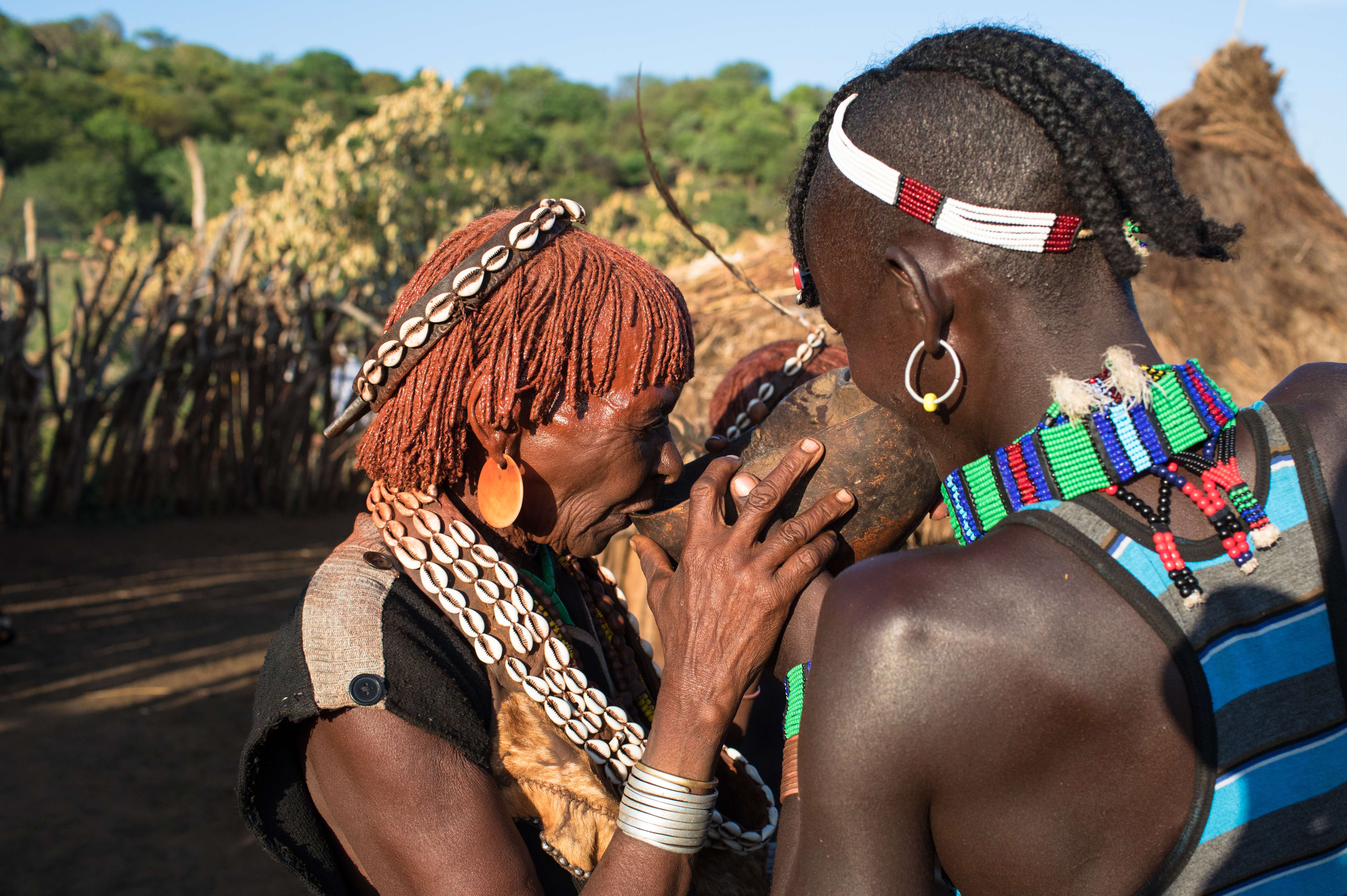 two Ethiopian females drinking water
